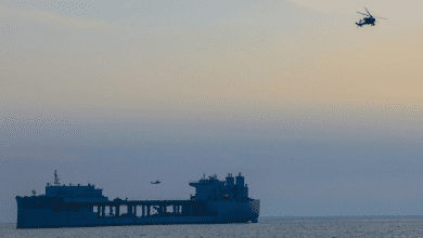 Photo of U.S. Navy Tests Army Attack Helicopters Aboard Landing Base Ship