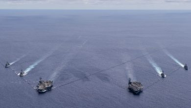 Photo of U.S. Navy Aircraft Carriers Conduct South China Sea Drills as China Watches