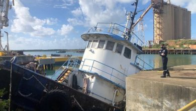 Photo of Partially Sunken Tug Leaking Oil in St. Croix